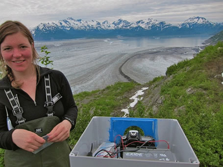 Barbara Truessel of UAF's Geophysical Institute sets up a time lapse camera near Yakutat Glacier which will become several glaciers because of melting.  Photo by Chris Larsen.
