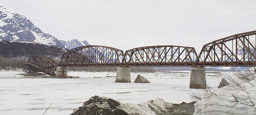 The Million Dollar Bridge, built for $1.4 million and completed in 1910, was the largest construction challenge of the Copper River and Northwestern Railway. The northern span fell in 1964 during the Good Friday Earthquake. Photo by Ned Rozell.