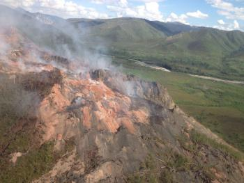 An aerial view of the Windfall Mountain Fire with the Tatonduk River in the background. National Park Service photo by Linda Stromquist.