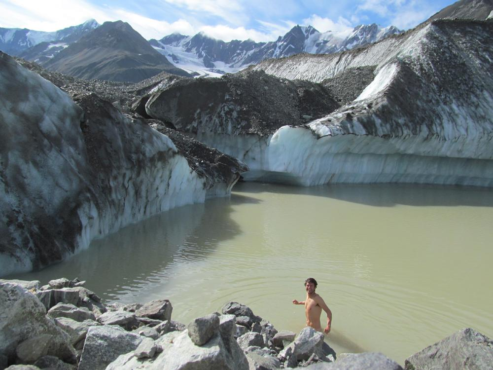Glacier researcher Sam Herreid baths in a lake on Canwell Glacier in the eastern Alaska Range. Photo by Sam Herreid